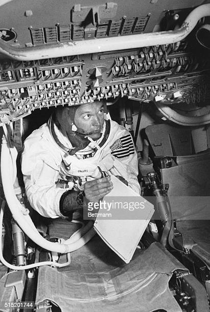 6/19/1969Kennedy Space Center FLApollo 11 Command Module Pilot Mike Collins holds a manual as he checks switches during practice in a command module...