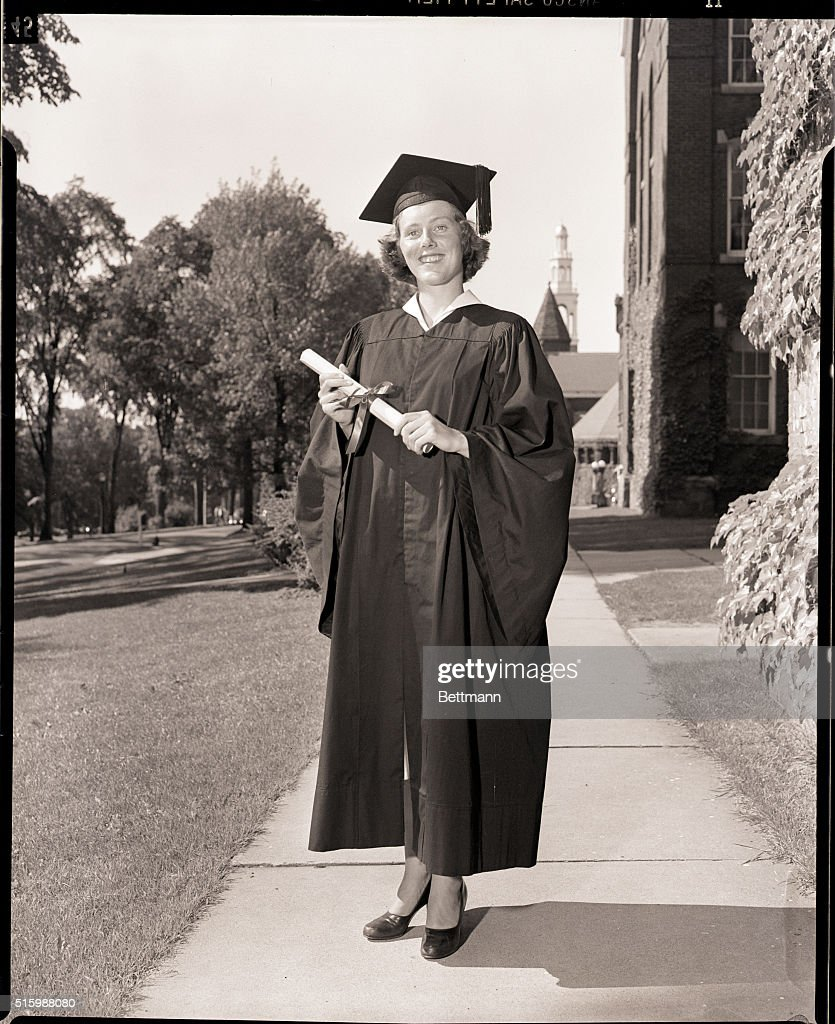 Female Graduate in Cap and Gown with Diploma Pictures | Getty Images