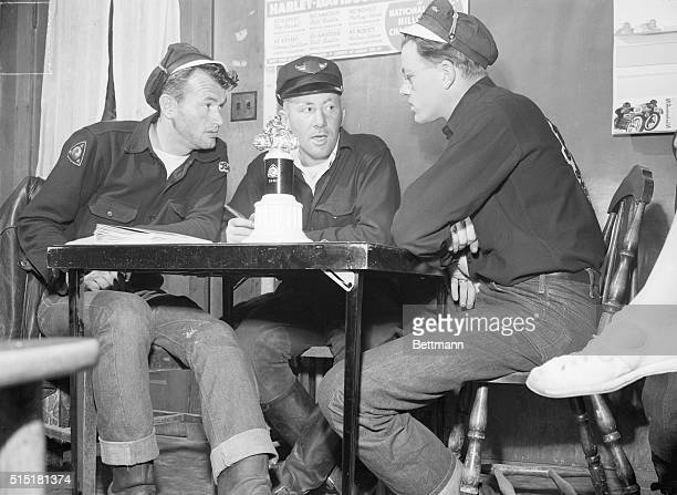 6/1951Seattle WA Final plans are talked over by officers of the Jolly Rogers Motorcycle Club Each member will have a job assigned to help make the...