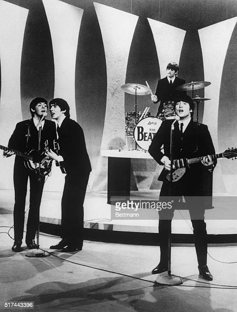 The Beatles are shown performing on the Ed Sullivan TV show.