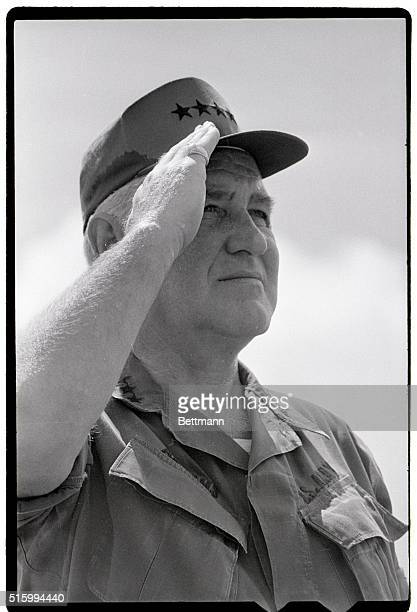 Saigon, South Vietnam- General Creighton W. Abrams, commander of U.S. Troops in Vietnam, salutes during ceremonies at the departure of the last major...