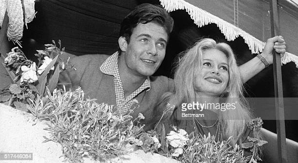 6/21/1959St Tropez France Newlyweds Brigitte Bardot and Jacques Charrier look out from a balcony while on their honeymoon The screen stars were wed...
