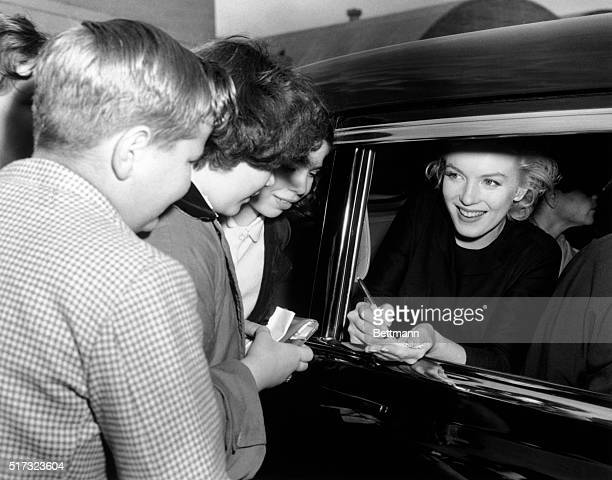 Marilyn Monroe signing autographs for children upon her arrival at Idlewild Airport from the coast Photograph 621956 shortly after her 30th birthday