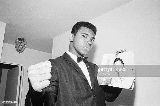 New York, NY- Heavyweight champion Cassius Clay expresses determination June 29 after announcing plans to fight Britain's Brian London, whose picture...