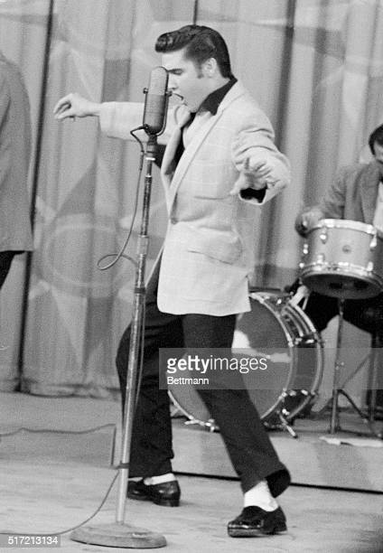 6/22/1956It's full steam ahead now as moans and grunts get louder and the tempo quickens Elvis Presley is in the midst of his gyrating...