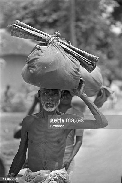 6/22/1971Kapotaskhi River India/East Pakistan Border Carrying his belongings and a sleeping mat an East Pakistani refugee makes his weary way to...