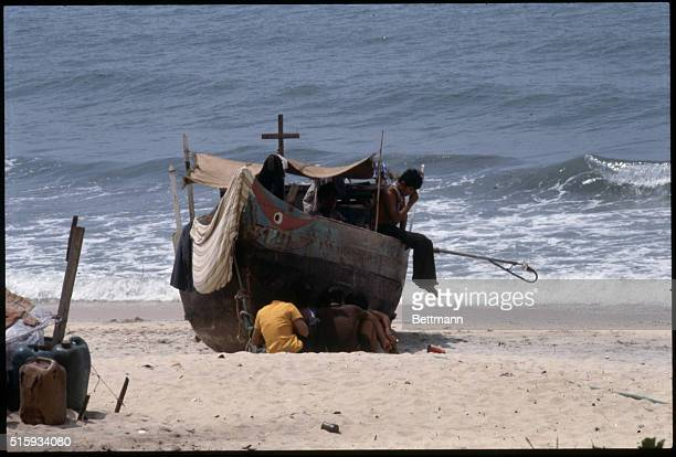 6/22/1979Kuantan Beach Malaysia Refugees aboard beached boat from Vietnam