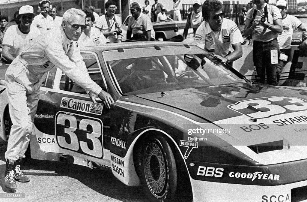 detroit  michigan- actor  race car driver paul newman pushes his car    news photo