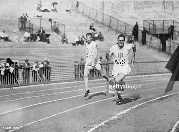 6/23/1924Paris France Picture shows relay team member Stephenson US taking the baton from Cochran in the semifinal 1600meter relay