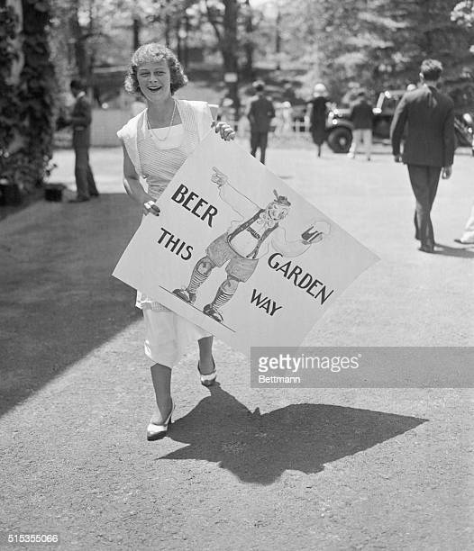 6/23/1933Manhasset NY Miss Nancy Heckscher carries a poster advertising the beer to be had at the Beer Garden at the annual GreenTree Fair on the...