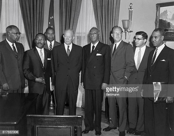 Washington, D.C.: Ike poses in the White House with Negro leaders, following their conference on problems of school integration and other matters....