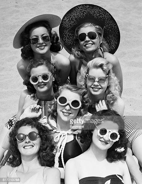 6/24/1941Venice California Although they may be looking at life through rosecolored glasses they are lookng at the beach through much darker ones The...