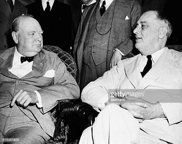 Washington, D.C.- Prime Minister Winston Churchill of Great Britain, , and President Franklin D. Roosevelt pictured during the meeting of the Pacific...