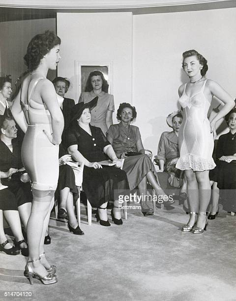 6/25/1949New York City Two figure molding costumes are modeled for buyers visiting the Bien Jolie Salon At left is a two piece bra and girdle...