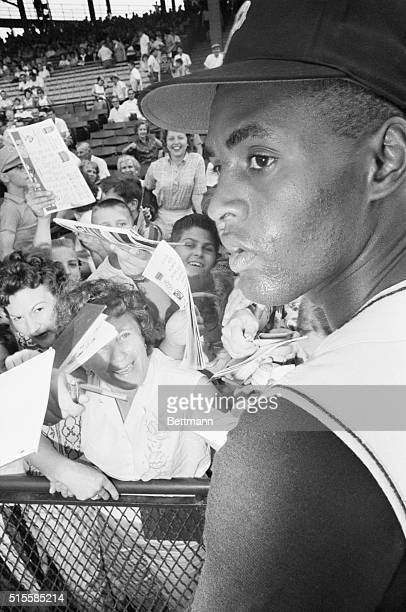 Pittsburgh, PA: Could I have your autograph please?--Fans converge on Pirates star rightfielder Roberto Clemente prior to game with New York Mets...