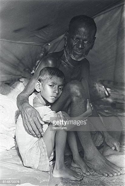 6/25/1971Calcutta India A young boy clutches his grandfather inside a tent in the refugee camp for Pakistanis near the Dum Dum Airport They are two...