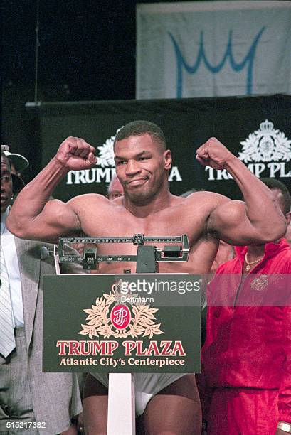6/25/1988Atlantic City NJ Mike Tyson flexes his muscles as he is weighed in before title bout vs Michael Spinks He weighed in at 218 1/4 pounds
