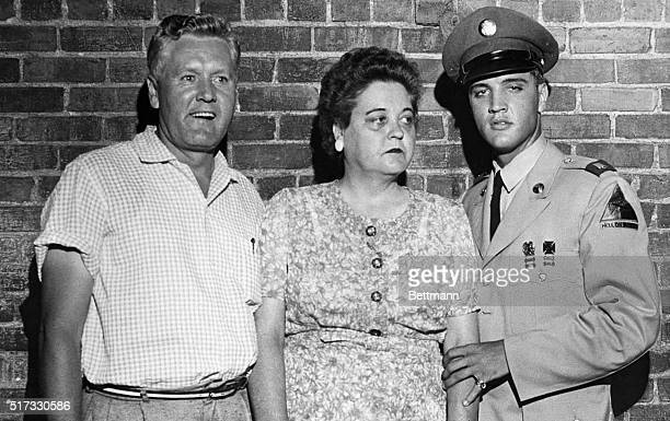 Memphis, Tennessee: Pfc. Elvis Presley, on his first leave from the Army, escorts his parents, Mr. And Mrs. Presley, from their mansion here to town...