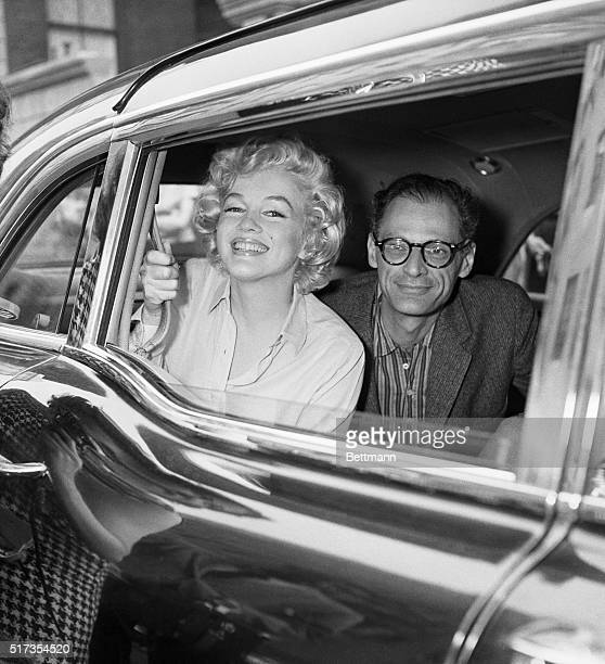 New York, NY: Marilyn Monroe & and Arthur Miller leaving Lenox Hill Hospital after her gynecological surgery.