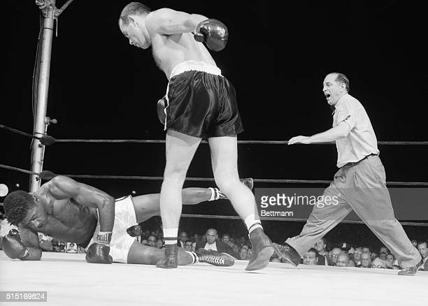 Yankee Stadium, NY- Heavyweight champion Floyd Patterson looks as though he is executing a stylish pirouette, but he is really in the act of falling...
