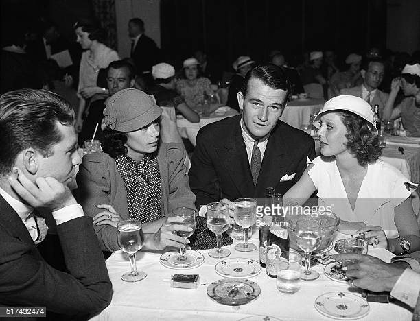6/27/1933Los Angeles CA John Wayne wellknown screen actor dines with his bride the former Josephine Saenz daughter of Dr Jose S Saenz the Panamanian...