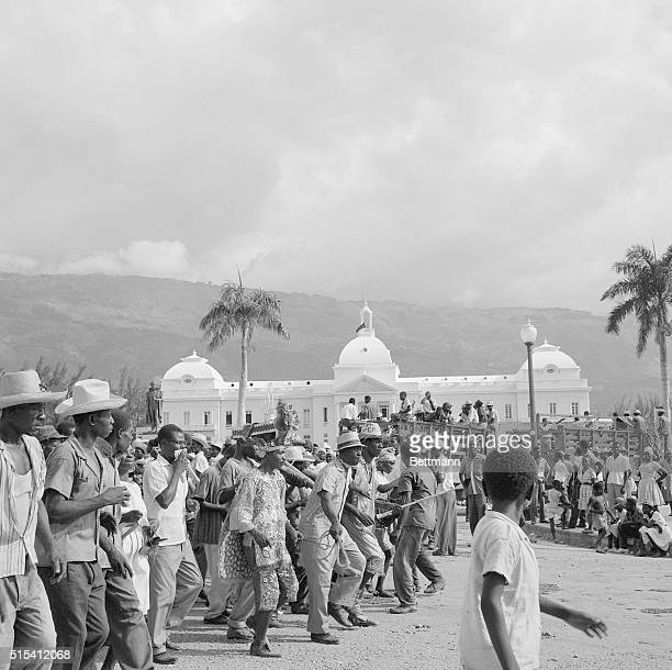 6/27/1964PortauPrince HaitiJubilant Haitians march past the gleaming white National Palace after Papa Doc took over the Presidency for Life The...