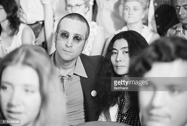 Washington, D.C.- Former Beatle John Lennon, sporting a short haircut, and his wife Yoko Ono, are among the spectators at the Watergate hearings...