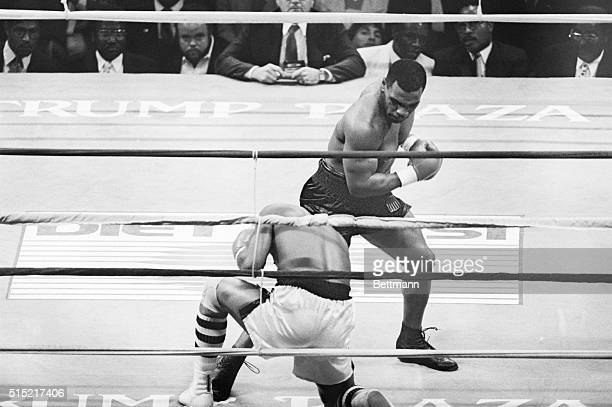6/27/1988Atlantic City New JerseyMike Tyson pounds Michael Spinks into submission as he knocks him out in the first round of their heavyweight title...