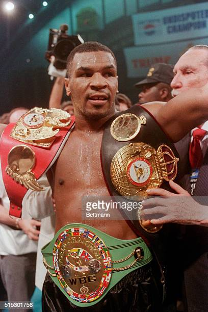 6/27/1988Atlantic City NJ Unquestionably the heavyweight champion of the world Mike Tyson shows off his 3 championship belts the WBC WBA and IBF...