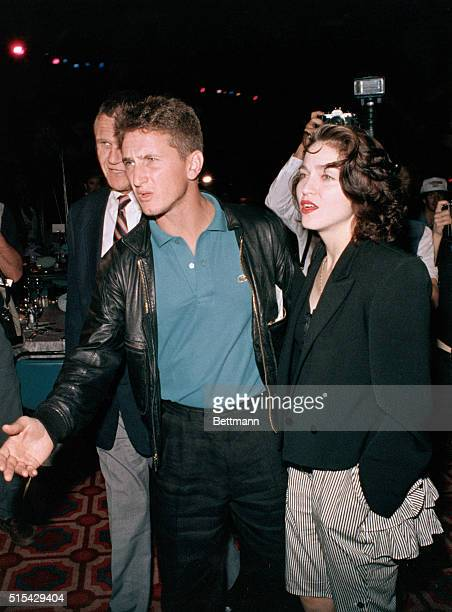 Madonna and her husband Sean Penn attend the TysonSpinks prefight party at Trump Plaza 6/27 Penn reportedly shoved a cameraman