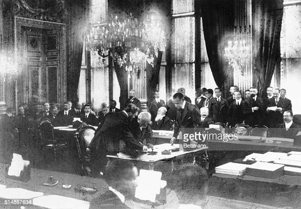 The historic scene in the Hall of Mirrors at Versailles, on June 28 five years to a day since the assassination of Ferdinand at Sarajevo, as Georges...