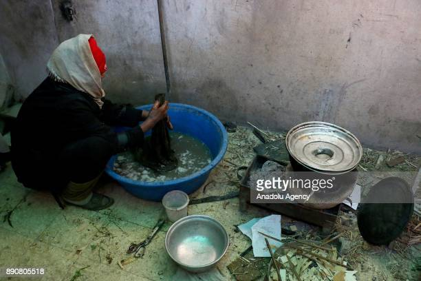 62yearold Pakistani woman Seqral Bibi who was isolated at Syrias Eastern Ghouta which is under blockade by Assad regime washes the clothes inside her...