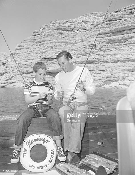 6/30/1951Las Vegas NV Movie swashbuler Errol Flynn pays rapt attention as he is given a lessonin the technique of attaching a leader to a fishing...