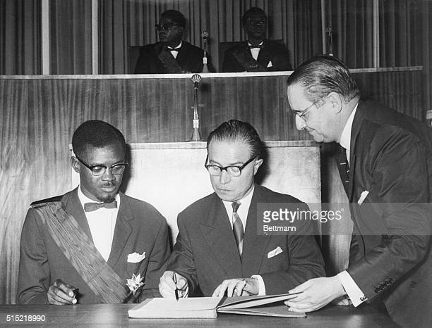 6/30/1960Leopoldville CongoMr Patrice Lumumba the Congolese Prime Minister and Mr Gaston Eyskens Belgian Premier sign the act of independence in the...