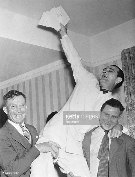Rep Lyndon Johnson rides on the shoulders of a pair of stalwart campaign workers in his hotel room where he and friends are listening to the latest...