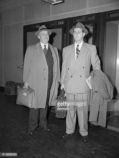 FBI Special Agent Robert Lamphere and FBI Assistant Director Hugh Clegg arrive at Idlewild Airport after spending two weeks questioning convicted...