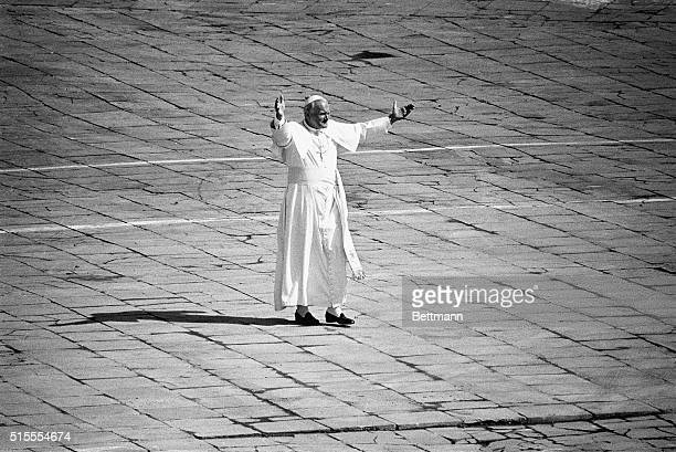 6/3/1979Warsaw Poland Pope John Paul II stands alone in Warsaw's Victory Square after it had been cleared for the landing of a helicopter that will...