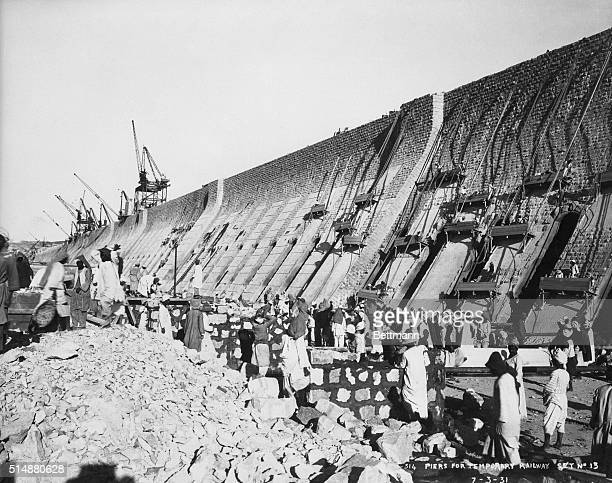 Piers under construction for the temporary railway needed to haul in the immense volume of stone required in the construction of the great Aswan Dam...