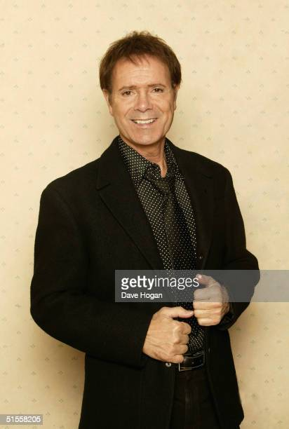 """Year old singer Sir Cliff Richard poses at a studio session to launch his new country album """"Something's Goin' On"""" on October 20, 2004 in Weybridge...."""