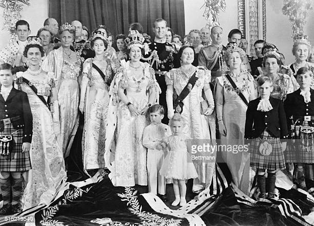 London, England-A smiling Queen Elizabeth poses with her family and members of the royal family in the throne room at Buckingham Palace, after her...