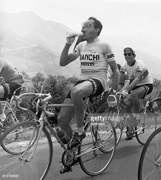 6/4/1955Ancona Italy As the Giro Bicycle Race 'caravan' rolls through Ancona towards the Adriatic coast Italy's ace Fausto Coppi sprays concentrated...