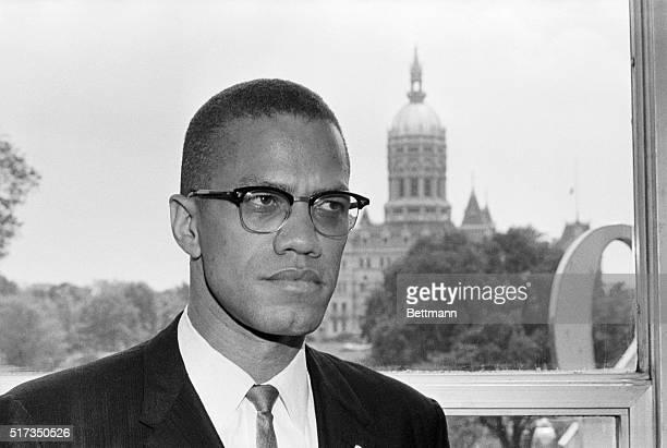 Malcolm X leading spokesman for the Black Muslim movement is shown with the dome of the Connecticut Capitol behind him as he arrived in Hartford for...