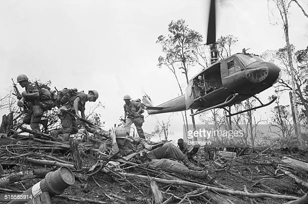 6/4/1968Dak To South Vietnam Troops of the 101st Airborne Division rush to take positions after jumping off a helicopter in a landing zone northwest...