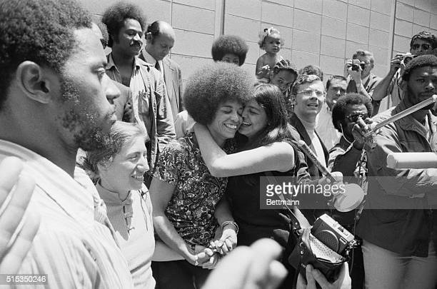 San Jose, CA- An exuberant Angela Davis is kissed by her friend Victoria Machado after Miss Davis was aquitted of all charges against her by an...