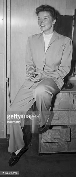 Star of stage and screen Katharine Hepburn becomingly clad in slacks unbent and gave an interview to the boys of the press as she sailed from New...