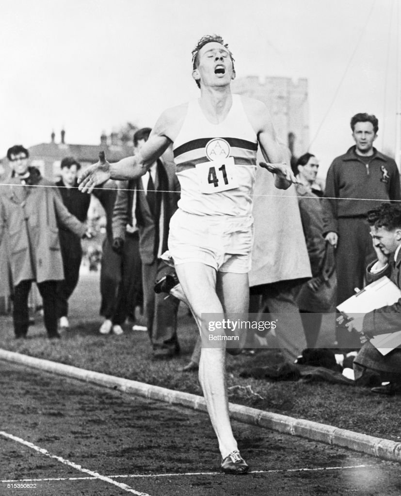 Mouth wide open gasping in air, with every tendon tight as a fiddle string, 24-year-old English medical student Roger Bannister is shown here breasting the tape and crashing his way into athletic history by completing the mile in 3 minutes 59.4 seconds at Oxford. He is the first man in history to run the mile and demolish the four minute barrier. BPA2 #1916