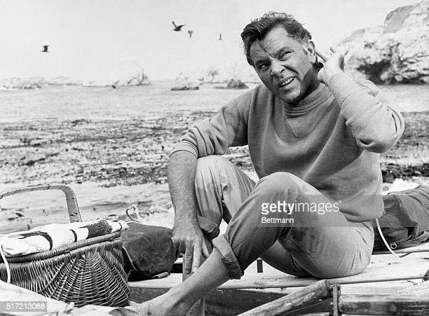 6/5/1965Though he appears to be enjoying himself at a beach picnic actor Richard Burton is actually working At this point he is cocking an ear to...
