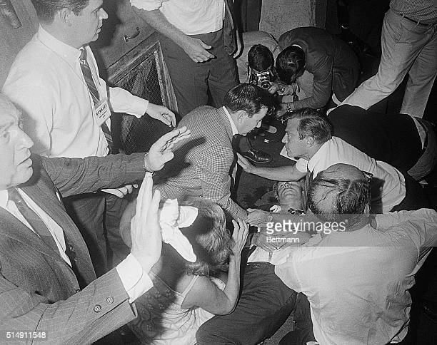 6/5/1968Los Angeles CA Shirt open one eye closed Sen Robert F Kennedy lies on the floor of the Ambassador Hotel after being shot by a man identified...