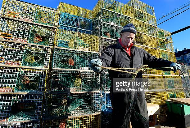 65yearold Jim Holden untangles lines as he begins his 57th year lobstering with his last 20 years working from Widgery Wharf in Portland He hopes...