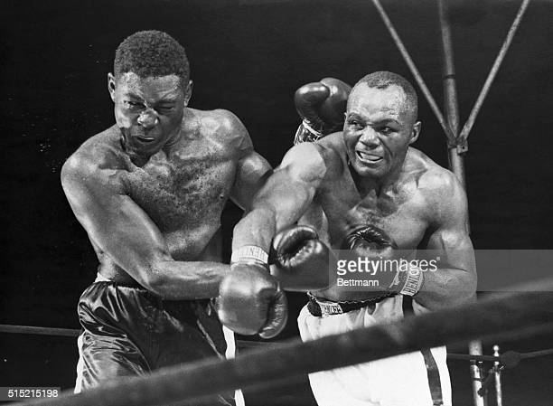 Philadelphia, PAMunicipal Stadium. Ezzard Charles winced as Jersey Joe Walcott bounced a hard right off of his chin in the seventh round of their...